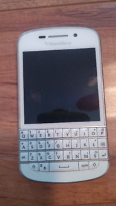 Blackberry Q10 with SIM card and charger.  Like new.