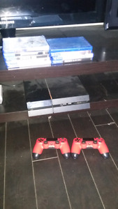 PS4 w 2 controllers and 9 games