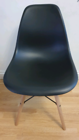 Six Eames-esque style chairs black with wooden legs