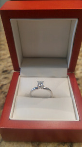 Engagement ring, 18kt white gold w/ princess cut .56ct diamond