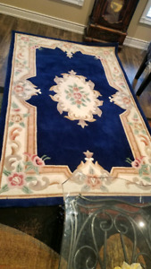 Rich luxurious red and dark blue carpets