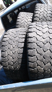 Tires and rims off a Dodge pickup truck 325 50R20