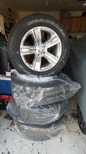 Brand new Dodge Ram 275/60R20 Tires and wheels