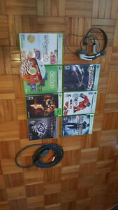 Xbox 360 games, headset, cord, and a ps3 game