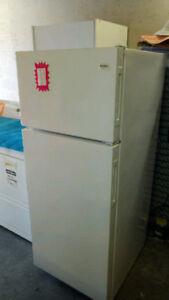 Apt size Kenmore refrigerator for sale.