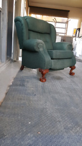 Antique large comfortable recliner with Wood carved claw feet