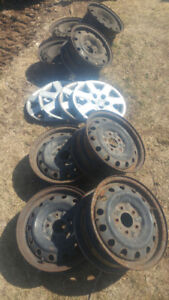 "2 Sets of 4, 15"" Steel Rims for Sale"
