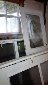 2 fenêtres a manivelle et un porte 34``