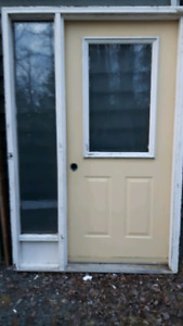 Residential entry door with side ligjt