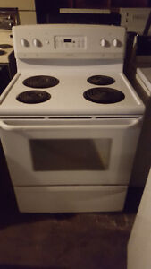 2 stoves for sale 1 white electric 100.00 and 1 black gas 200.00