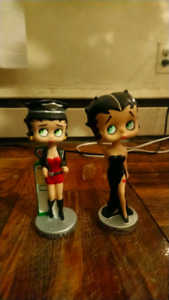 Two Betty boop bobble heads