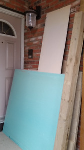assorted doors, wood and drywall pieces