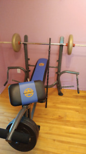Weight bench with weights and 2 bars.