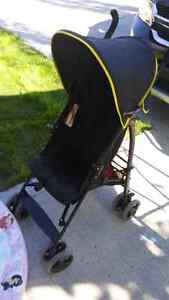 2 strollers and a toddler bed