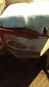 Newborn diapers huggies and pampers