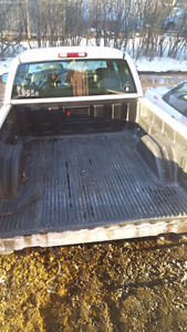 Rugged plastic bedliner from 2004 GMC 6.5 foot box
