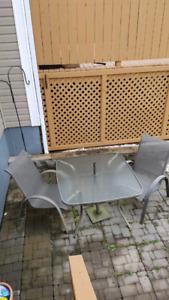 Glass top patio set with 2 chairs and umbrella holder