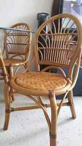 "Rattan 42"" glass table and four chairs"