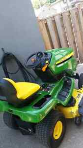 "Brand new.  John Deer X350 HD Tractor with 48"" Deck"