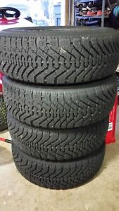 4 Goodyear Nordic 215/65/15 Snow Tires and Rims