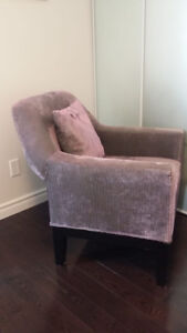 Comfortable armchair with shiny purple stripes patterned fabric