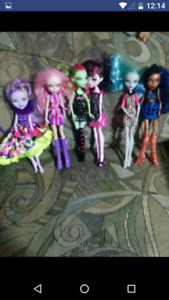 Monster high dolls and 1 ever after high doll