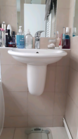 Bathroom sink, wall-hung, with tap