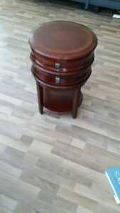 Brown wood, circular 2-drawer table, with shelf, from Bombay.