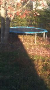 14 foot trampoline and basketball hoop on own stand 100OBO