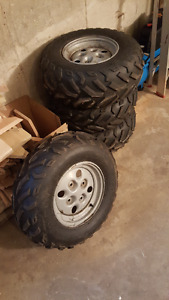 Stock tires and rims off Arctic Cat 450