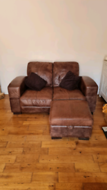 Leather sofa with ottoman foot rest.