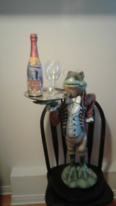 FROG holding wine bottle & glasses