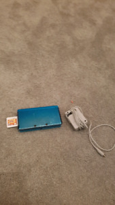 Nintendo 3DS with game and charger