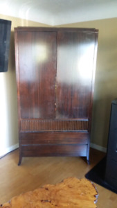 Solid armoire /  entertainment stand