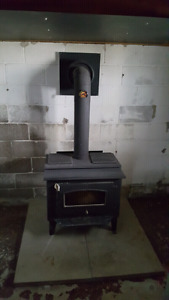 Wood stove and insulated pipes
