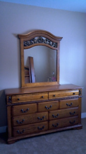 Queen size bed with dresser and mirror