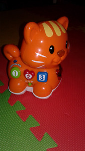 Various baby toys.   activity table, toys