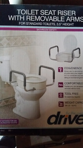 Toilet seat rail with adjustable arms by DRIVE