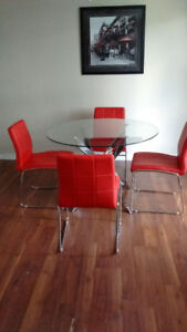 Dining room glass round table four leather like chairs