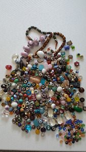 COLLECTION OF VARIOUS BEADS AND CHARMS