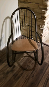 Metal rocking chair with leather seat.