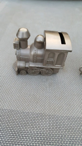 Babies first Tooth, Curl and Piggy bank Train