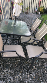 table , with 5x recliner chairs , 2x footstools , and parasol