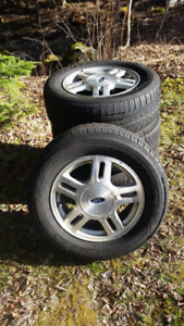 4 x 235/60 R16 Goodyear Tires on 2005 Ford Freestar Alloy Rims