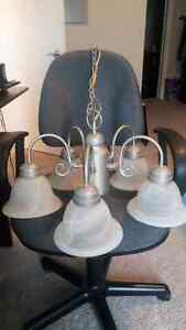I'm  selling a 5 light satin silver  chandelier in perfect cond)