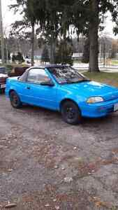 92 convertible Geo Metro 5 speed.