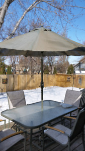 Glass top Patio Table W/4 Chairs