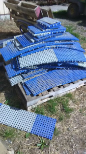 pile of used interlocking plastic floor grate tiles
