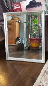 Beveled mirror with frame.