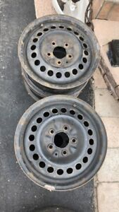 """FOUR USED 17"""" Steel car rims for snow tires"""